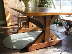 detail of reclaimed barn wood crossbuck trestle table base - E. Braun Farm Tables and Furniture, makers of custom reclaimed barn wood furniture in Lancaster County, PA, braunfarmtables.houzz.com