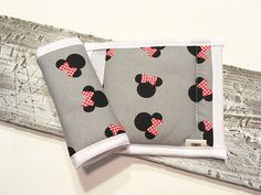 Everyone loves Minnie and comfort...comfy seatbelt strap covers.