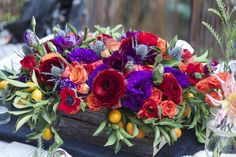 "Flower Recipe: 2 Bunches Red Anemone, 1 Bunch Purple Lisianthus, 1 Bunch Burgundy Ranunculus, 1/2 Bunch ""Babe Orange"" Spray Roses, 2 Large Kumquat Branches, Blue Eryngium Thistle ""Super Nova"" to taste we recommend 5-7"