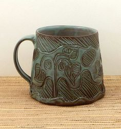 Handmade carved ceramic mug by flyingpignc on Etsy, $24.00