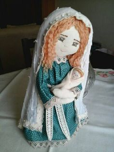 Check out this item in my Etsy shop https://www.etsy.com/listing/227622379/holly-mary-and-baby-jesus-fabric-art