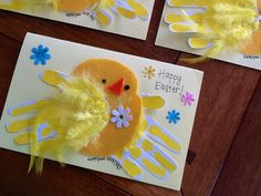 Didn't quite like the handprint chicks I found as examples...so I adapted my own! Just in time for Easter cards.  Used: Yellow acrylic paint for handprints on white card stock Yellow feathers to cover wing (and one sideways for chest) Yellow felt for body  Orange felt for beak Black paint (acrylic squeeze fine tip) Scrap booking flowers Yellow card stock for card base