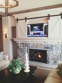 Cool farmhouse style hidden tv.                                                                                                                                                      More