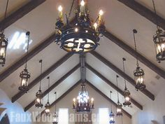 faux wood beams, very cool.  Love those chandeliers!