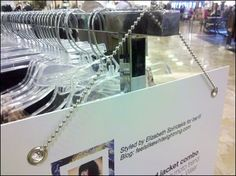 A pleasant, clean and modern looking sign holder arrangement created through use of Ball Chain and Grommet equipped signage. Store Window Displays, Ball Chain, Signage, Retail Experience, Organization, Pop, Getting Organized, Organisation, Popular