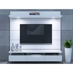 Wade Logan Julius Entertainment Center for TVs up to Color: White GlossFound it at Wayfair - Julius Entertainment CenterBring your abode into the century in seconds with this distinctive Julius Entertainment Center. This Entertainment Center is perfect wh Tv Wanddekor, Floating Entertainment Center, Entertainment Centers, Wall Mounted Entertainment Unit, Marvel Entertainment, Entertainment Products, Ruang Tv, Floating Tv Stand, Floating Tv Unit
