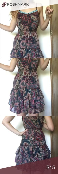 Colorful Patterned Sundress This colorful paisley sundress is super cute! The skirt is layered and there are strings that allow you to tie the dress snug around your waist. The shoulder straps are adjustable. Dresses Mini
