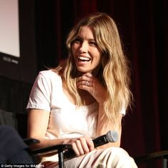 She's a powerful woman: Beaming Jessica Biel goes for a chic look in satin trousers as she...