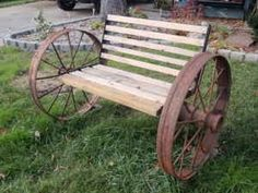 Google Image Result For  Http://images1.americanlisted.com/nlarge/steel_wagon_wheel_bench_perfect_for_the_gardens_150_janesville_8287942