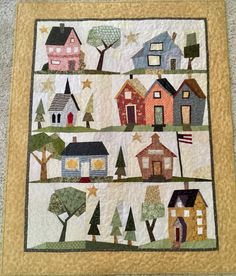 """My kinda town"" pattern by Fiberworks. My mother's interpretation includes a park instead of the store fronts. Love it!!!!"