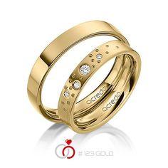 1 Paar Trauringe - Legierung: Gelbgold 585/- Breite: 4,00 - Höhe: 1,80 - Steinbesatz: 4 Brillanten zus. 0,081 ct. tw, si (Ring 1 mit Steinbesatz, Ring 2 ohne Steinbesatz)