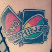 Tattoo in memory of my Grandfather. UNO was the first card game he taught me how to play. His last name was Kitsmiller. I miss him so much and every time I look at that tattoo I smile and remember all the fun we had. Love you Granddaddy!!