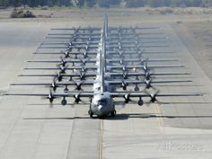 A Line of C-130 Hercules Taxi at Nellis Air Force Base, Nevada Photographic Print by Stocktrek Images at AllPosters.com