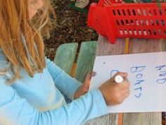 Blog Post about The Montessori Outdoor Classroom: Academic Learning & Children Making Outdoor Signs!