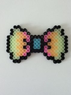 Perler Bead bows made out of beads that glow in the dark.
