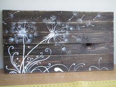 took an old pallet apart. Used half of the boards and stained them. Then painted some dandelions using acrylic paints. This is now hanging in my studio.
