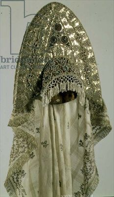 Credit: Kokoshnik (head-dress) from a woman's festive national costume, Russian, second half of the 19th century (cloth, galloon, embroidery, muslin) (see also 74554) / Hermitage, St. Petersburg, Russia / The Bridgeman Art Library