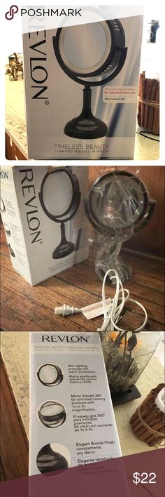 REVLON SWIVEL MIRROR Product Summary Bronze beauty mirror comes with 1x and 1xd magnification Perfect for regular viewing or close-up details Features a 360 degree rotation Lighting provides soft warm illumination on the rim New never used Revlon Makeup Brushes & Tools