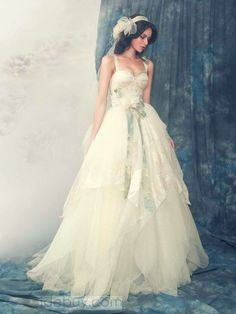 very romantic wedding dress - the top might be a little too lingerie-esque for me, but beautiful nonetheless! Plus - hair.