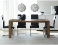 Hamburg dining table with a greyed acacia wood finish and timeless silhouette, this table pairs up perfectly with just about any chair —from dark and dramatic to light and playful. Structube.com