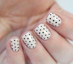 Have fun nails that are still appropriate for work with minimalistic nail art designs! See how to make stripes, polka dots or a reverse french manicure to give your nails a pop of color without being too crazy.