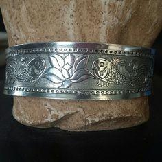 Band bracelet Adjustable bracelet. Silvertone with decorative engraving. Brand new. Jewelry Bracelets