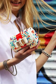 Mini Christian Louboutin clutch with multicolored spikes