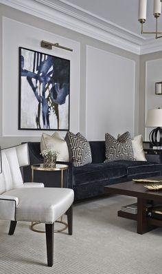 Deep navy blue is elegant in luxurious in this modern living room