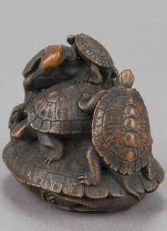 Wood netsuke of turtle group, carved by Hoju, mid-19th century.