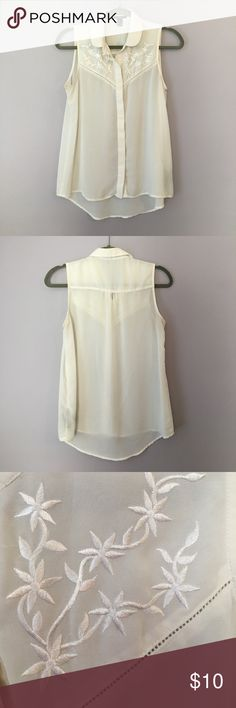 Sheer sleeves blouse. Small sleeveless sheer blouse from Forever 21. Hi-lo cut and cream colored. Beautiful embroidery on front neckline area. Great for work with a pencil skirt or with jeans and cowboy boots for those summer concerts. Forever 21 Tops Blouses