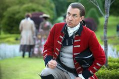 Black Jack Randall gets on his knees before King Louis XV at Versailles
