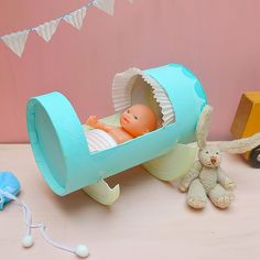 Recycle an empty oatmeal container (or TP-roll!!) into an adorable cradle for your child's dolls!
