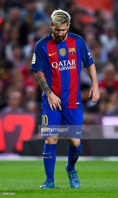 Lionel Messi of FC Barcelona reacts injured during the La Liga match between FC Barcelona and Club Atletico de Madrid at the Camp Nou stadium on September 21, 2016 in Barcelona, Spain.