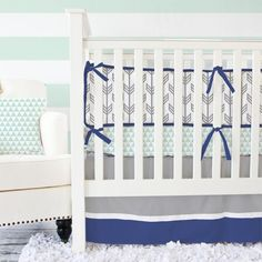 We are obsessed with our navy and gray arrow bumpers! We love the soft and vibrant mix of colors which look amazing in any nursery!