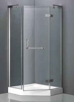corner shower units with stylish grass door and stainless steel handle for small bathroom in grey wall scheme