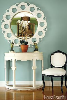 "Sherwin-Williams Hazel ""This blue-green was ideal in a 1920s seaside bungalow. It's beachy, but it's also classic. I could see it in a European breakfast room. The mirror pops against it—that contrast is the key to making this tiny foyer feel dynamic."" —Jaime Rummerfield  Make it yours: Sherwin-Williams Hazel 6471"