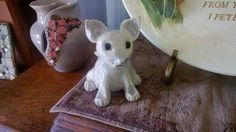 A personal favorite from my Etsy shop https://www.etsy.com/listing/157880319/handmade-pottery-sculpted-kitty-cat