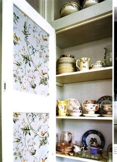 i like the idea of putting wallpaper on the inside of your cupboards so its a lovely secret surprise when you open them :)