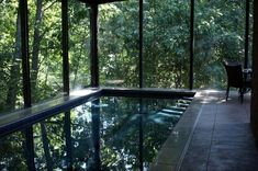 This indoor pool surrounded by nature is absolutely stunning - purchase your dream home at AgapeLuxury.com