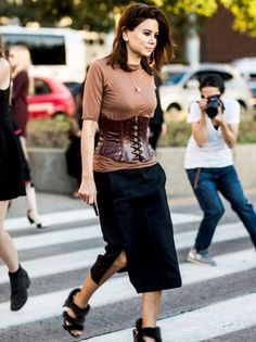 After its appearance onthe runway and some of our favorite street style stars, corset-dressing has arrived as a major trend. Style yours over a T-shirt or button-down to give it the 2017 twist.