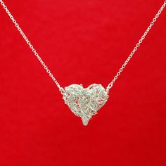 Beautiful but PETITE interwoven heart necklace.  Gotta love sustainable jewelry!