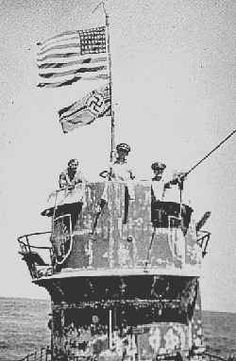 Capture of U-505, Officers from USS Guadalcanal in the conning tower of the captured U-505. From left to right: Commander Trosino, Captain Gallery and Lt. Albert David. June 4, 1944, USA.