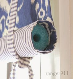 Continuing with the nautical theme, I rolled the blinds around pool noodles from the dollar store to keep them from drooping.It's a cheap trick and it works like a charm! Ranger Decorating with selfies. Roll Up Curtains, Diy Curtains, Nautical Bathroom Design Ideas, Nautical Bathrooms, Diy Yard Decor, Diy Kitchen Decor, Beach Wall Decor, Beach House Decor, Nautical Blinds