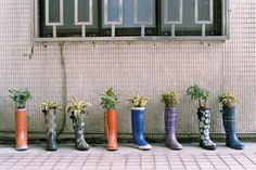 cute idea for spring window display... start collecting rain boots!