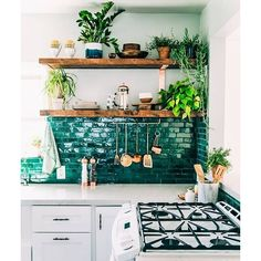 Just your average swoon-worthy kitchen with emerald backsplash. (Photo via @justinablakeney) #everydayIBT
