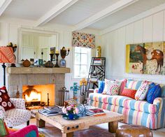 love the mix of colors and bright prints--this is a happy living room!