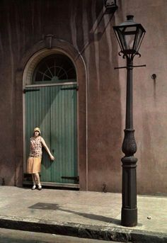 French Quarter Fashion In this 1930 National Geographic photo, a woman stands by the doors of a theater in New Orleans' French Quarter.