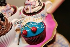 """Such an interesting cupcake! Love the """"cups"""" on the cakes in the background."""