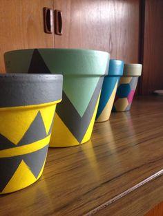 Geometric hand painted terracotta pots
