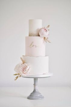 Love the script on the second tier of this soft and pretty wedding cake unique wedding cakes 47 unique takes on the traditional white wedding cake 41 Vegan Wedding Cake, Pretty Wedding Cakes, Floral Wedding Cakes, Amazing Wedding Cakes, White Wedding Cakes, Elegant Wedding Cakes, Wedding Cake Designs, Pretty Cakes, Beautiful Cakes